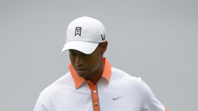 Tiger Woods flips his ball to himself after finishing on the third green during the pro-am of the Arnold Palmer Invitational golf tournament in Orlando, Fla., Wednesday, March 20, 2013.(AP Photo/Phelan M. Ebenhack)