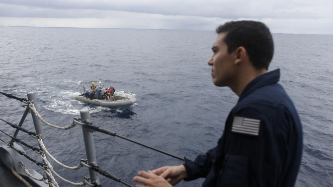 ADVANCED FOR USE SUNDAY FEB. 3 AND THEREAFTER In this Thursday, Oct. 11, 2012 photo a U.S. Coast Guard officer watches as a RHIB boat returns to the USS Underwood after participating in drug interdiction training exercises while patrolling in international waters near Panama. In the most expensive initiative in Latin America since the Cold War, the U.S. has militarized the battle against drug traffickers, spending more than $20 billion in the past decade.  U.S. Army troops, Air Force pilots and Navy ships outfitted with Coast Guard counternarcotics teams are routinely deployed to chase, track and capture drug smugglers. (AP Photo/Dario Lopez-Mills)