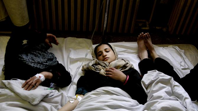 Afghan school girls receive treatment after becoming ill, at a hospital in Kabul, Afghanistan, Wednesday, May 1, 2013. Amanullah Eman, a spokesman for the Education Ministry, said some students were briefly hospitalized but all were doing well. He said a number of factors were being investigated, including the use of fertilizers in nearby farm land. (AP Photo/Ahmad Jamshid)