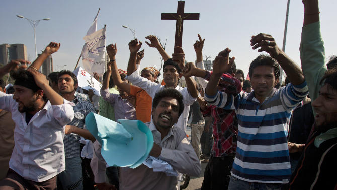 Pakistani Christians chant slogans during a demonstration demanding that the government rebuild their homes after they were burned down following an alleged blasphemy incident, in Islamabad, Pakistan, Sunday, March 10, 2013. The incident in Lahore began on Friday, March 8, 2013 after a Muslim accused a Christian man of blasphemy, an offence that in Pakistan is punished by life in prison or death. (AP Photo/Anjum Naveed)