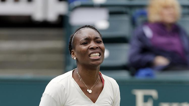 Venus Williams reacts to a bad shot against Varvara Lepchenko at the Family Circle Cup tennis tournament in Charleston, S.C., Friday, April 5, 2013. (AP Photo/Mic Smith)