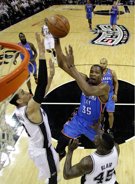 Kevin Durant #35 Of The Oklahoma City Thunder Shoot The Ball Over DeJuan Blair #45 And Daniel Green #4 Of The San  Getty Images