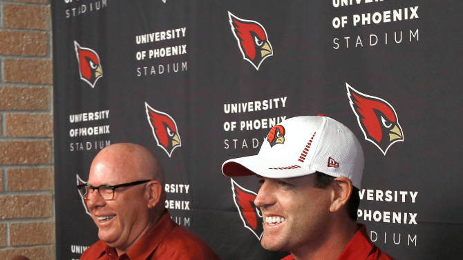 Arizona Cardinals quarterback Carson Palmer, right, and coach Bruce Arians speak to the media during a news conference, Tuesday, April 2, 2013, at the NFL football team's training facility in Tempe, Ariz. (AP Photo/Matt York)