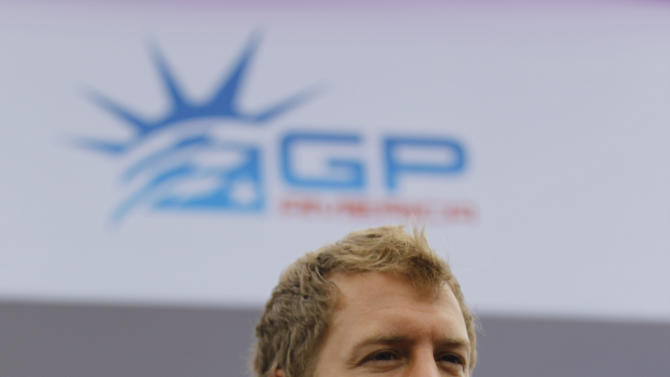 Defending Formula One champion Sebastian Vettel, of Germany,  talks talks to the media, Monday, June 11, 2012 in Weehawken, N.J. Vettel drove a 3.2-mile course to demonstrate the planned route for next year's Grand Prix of America race.  (AP Photo/Julio Cortez)