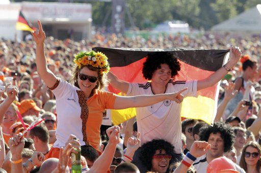 Dutch and Germany soccer fans shout slogans as they party at the Euro 2012 fan zone in Kharkiv