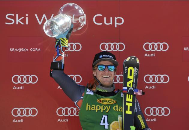 Winner Ted Ligety of the US celebrates after the Alpine Skiing World Cup men's giant slalom ski race in Kranjska Gora