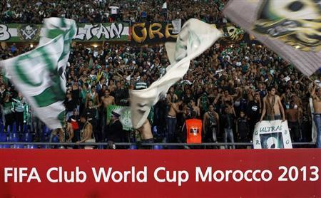 Raja Casablanca's fans celebrate winning their FIFA Club World Cup semi-final match against Atletico Mineiro at Marrakech stadium