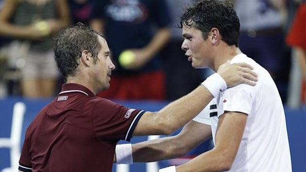 Milos Raonic of Canada (R) congratulates Richard Gasquet of France after Gasquet's win at the U.S. Open tennis championships in New York, September 2, 2013 (Reuters)