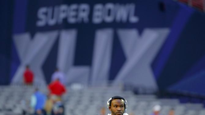 New England Patriots wide receiver Josh Boyce warms-up on the field before the NFL Super Bowl XLIX football game against the Seattle Seahawks in Glendale
