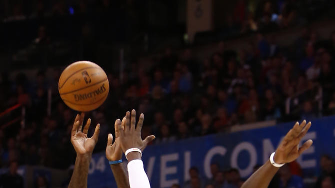 Charlotte Hornets forward Marvin Williams (2) shoots as Oklahoma City Thunder guard Reggie Jackson (15) defends during the second quarter of an NBA basketball game in Oklahoma City on Friday, Dec. 26, 2014. (AP Photo/Alonzo Adams)