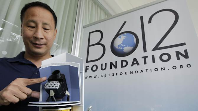 Ed Lu, Chairman of the B612 Foundation, shows the telescope of a model of the Sentinel Space Telescope during a news conference in San Francisco, Thursday, June 28, 2012. The group of ex-NASA astronauts and scientists on Thursday announced they plan to launch a privately-funded space telescope to search for small asteroids that may pose a danger to Earth. (AP Photo/Paul Sakuma)
