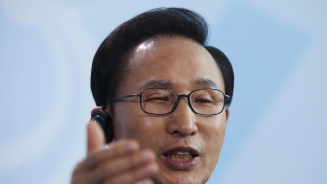 South Korean President Lee Myung-bak briefs the media after a meeting with German Chancellor Angela Merkel, not pictured, at the chancellery in Berlin, Germany, Monday, May 9, 2011. (AP Photo/Markus Schreiber)