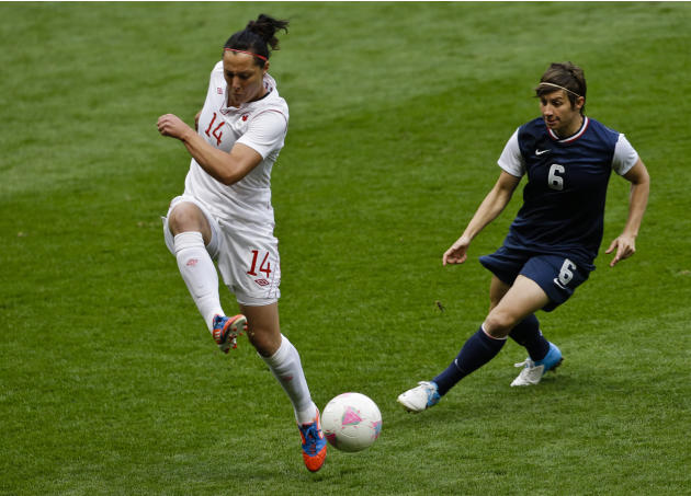United States' Abby Wambach, left, takes the ball from Canada's Kaylyn Kyle during the semifinal women's soccer match between the USA and Canada in the 2012 Summer Olympics, Monday, Aug. 6, 2012, at O