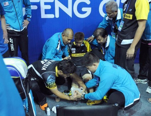 Lee Chong Wei of Malaysia receives medical attention