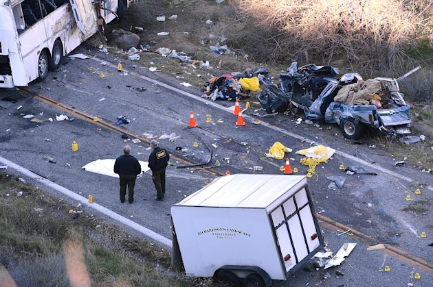 <p>               Authorities work Monday Feb. 4, 2013, at the scene of Sunday's fatal tour bus crash on Highway 38 north of Yucaipa, Calif., that left at least eight people dead and dozens injured. The cause of the Sunday crash east of Los Angeles remained under investigation. (AP Photo/The Sun, Rick Sforza)