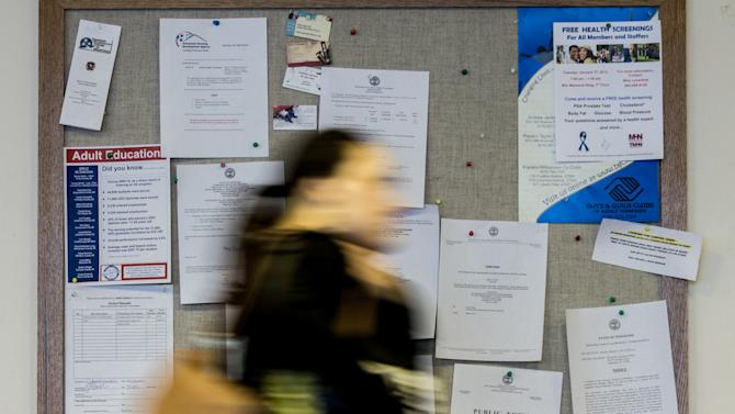 A woman walks by a board of public notices at the legislative office complex in Nashville, Tenn., on Friday, March 9, 2012. Tennessee has at least 200 boards and commissions that do everything from promoting soybeans to licensing dentists to overseeing the state's colleges and universities. Almost all of them are required to invite the public to attend their meetings, but the way they do that is inconsistent at best. (AP Photo/Erik Schelzig)