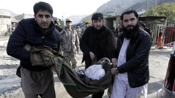Afghan men carry a sick elderly man from Afghanistan to Pakistan for treatment at the main border crossing of Torkham, east of Kabul, Afghanistan, Saturday, Dec. 29, 2012. Today is the second day that Torkham the main border between Afghanistan and Pakistan is closed by Pakistani authorities, hundreds of trucks, cars plus several hundred people including, women, children, elders and especially sick people who are going from Afghanistan to Pakistan for treatment are waiting for the border to open, there are reports of at least three civilians being killed in Afghanistan side and more than five others being killed in Pakistan side since the border is closed because of the cold weather and heavy rain (AP Photo/Rahmat Gul)