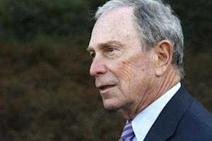 """Bloomberg talks to reporters after meeting with Obama and business and civic leaders for an event to discuss his """"My Brother's Keeper"""" initiative at the White House in Washington"""