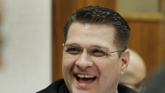 Adam Longoria smiles at his attorneys after being granted a second preliminary hearing by Judge Kitts during a motions hearing in his murder case in Great Bend, Kan., Thursday, July 21, 2011.   Longoria is accused of killing a 14-year-old Great Bend girl whose burned body was found at an asphalt plant. (AP Photo/Orlin Wagner)