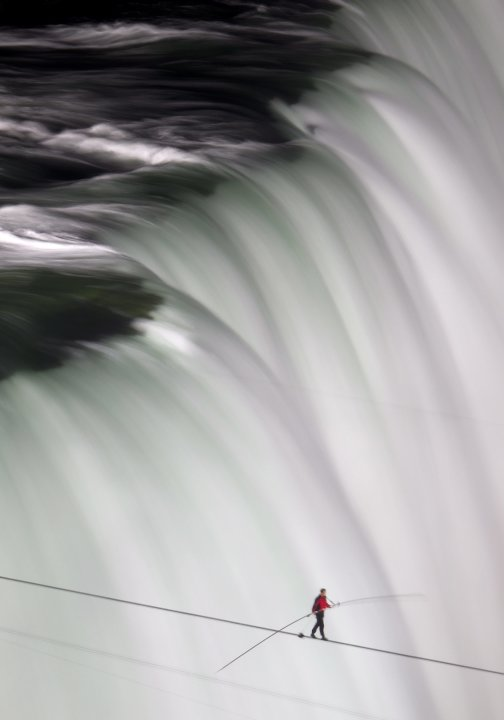 Nik Wallenda walks over Niagara Falls on a tightrope in Niagara Falls, Ontario, on Friday, June 15, 2012. Wallenda has finished his attempt to become the first person to walk on a tightrope 1,800 feet