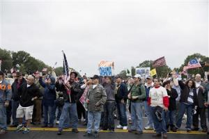 """Protesters with """"Million Vet March on the Memorials"""" rally in front of National U.S. World War II Memorial in Washington"""