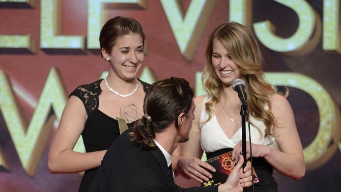 Haley Conner and Cara Gordon of So. IL University, Carbondale, College of Mass Comm. & Media Arts accepts the Magazine College Television Award from Eric Balfour (C) onstage at the 34th College Television Awards presented by the Academy of Television Arts & Sciences Foundation at the JW Marriott Los Angeles L.A. Live on April 25, 2013 in Los Angeles, California. (Photo by Phil McCarten/Invision for the Academy of Television Arts & Sciences/AP Images)