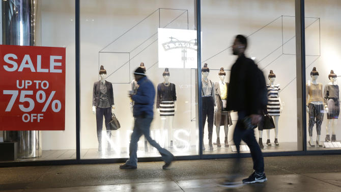 Holiday sales rise on discounts, online shopping