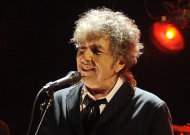 "FILE - In this Jan. 12, 2012 file photo, Bob Dylan performs in Los Angeles. The electric guitar that Bob Dylan plugged in at the Newport Folk Festival in 1965 may be the most historic instrument in rock music, and it has sat mostly unnoticed in a New Jersey attic for most of the 47 years since. Dylan left it behind in an airplane and it was taken home by the pilot. The late pilot's daughter recently took it to PBS' ""History Detectives,"" who authenticated the potentially fortune-making find in an episode that will air starting next Tuesday, July 17. (AP Photo/Chris Pizzello, File)"