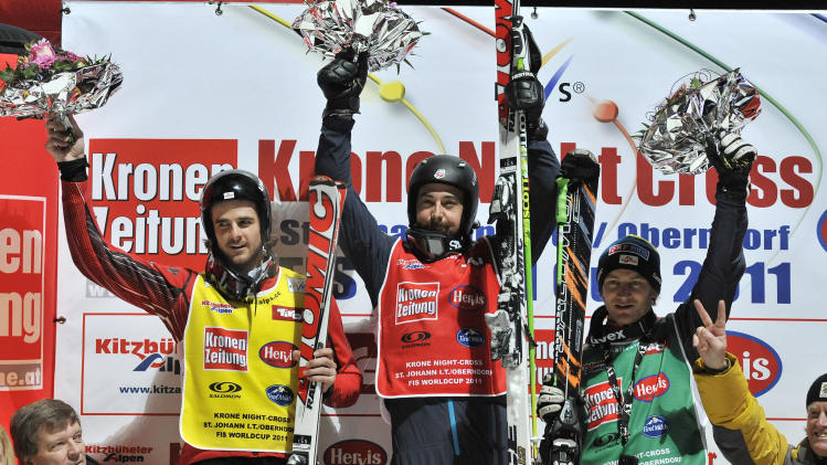 Second placed Nick Zoricic from Canada , left , winner John Teller, center, from the United States  and Austria's Thomas Zangerl  celebrate on the podium after  the men's skicross final at the World Cup ski event in St. Johann in Tyrol, Austria , Friday, Jan. 7, 2011. (AP Photo/Kerstin Joensson)