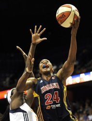 Indiana Fever's Tamika Catchings (24) goes up for a basket while guarded by Connecticut Sun's Tina Charles in the first half of a WNBA basketball game in Uncasville, Conn., Wednesday, Sept. 19, 2012. (AP Photo/Jessica Hill)