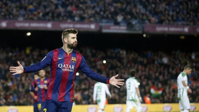 Barcelona's player Pique celebrates a goal against Cordoba during their Spanish First division soccer match in Barcelona