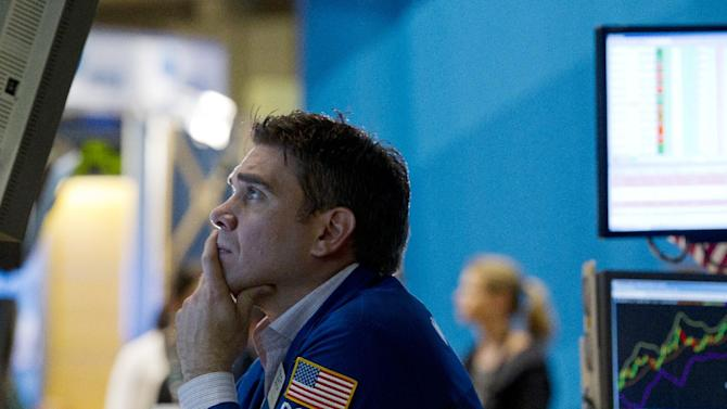 A trader works on the floor of the New York Stock Exchange on Friday, Aug. 26, 2011 in New York. (AP Photo/Jin Lee)