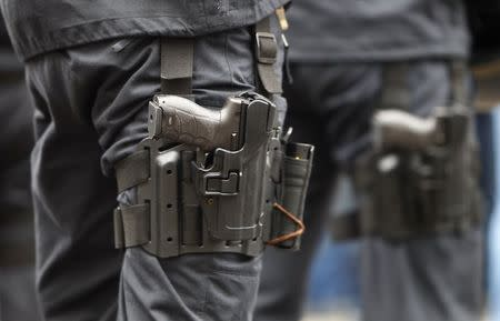File photo of a Heckler & Koch P30 handgun strapped to the leg of a German police officer