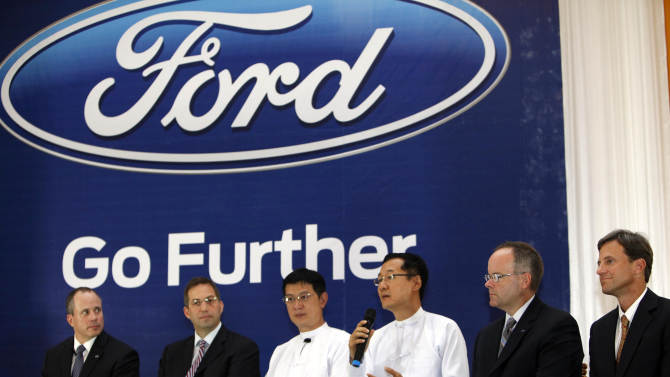 Ko Ko Gyi, third right, managing director of Capital Diamond Star Group whose unit will distribute Ford vehicles in Myanmar, speaks during Ford's launching ceremony Tuesday, April 30, 2013 in Yangon, Myanmar. Ford Motor Co. announced its entry into Myanmar on Tuesday, saying it plans to open the nation's first sales and service showroom for new vehicles by August. (AP Photo/Khin Maung Win)