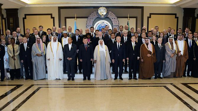 """Representatives from member states, UN agencies, and non-governmental organizations pose for a group photo at Bayan Palace in Kuwait City, Wednesday, Jan. 30, 2013. The U.N. chief made a dramatic appeal Wednesday for a major boost in relief aid for Syria, calling for an end to the fighting """"in the name of humanity"""" as an international conference opened in Kuwait with both foes and backers of President Bashar Assad. (AP Photo/Gustavo Ferrari)"""