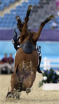 Hwang Woojin, of South Korea, and his horse Shearwater Oscar, fall down after the horse bucked after the starting bell sounded to start their run in t