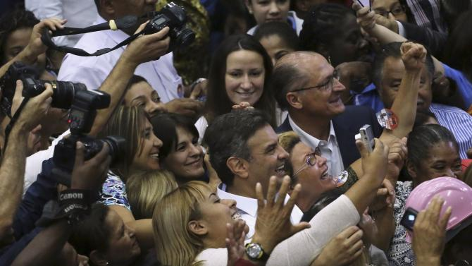 Brazilian Social Democratic Party (PSDB) Presidential candidate Neves and Governor candidate Alckmin pose with supporters during their campaign rally in Sao Paulo