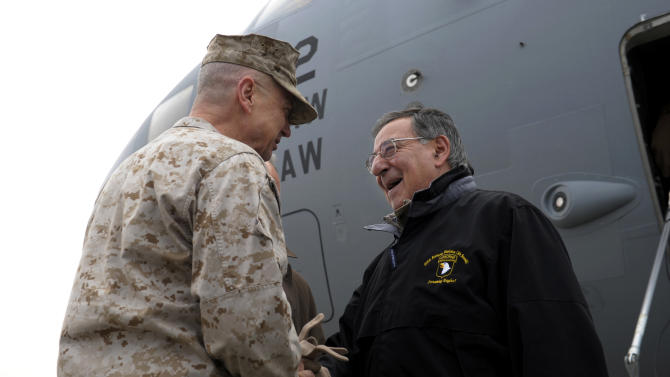U.S. Defense Secretary Leon Panetta, right, is greeted by Marine Gen. John R. Allen, left, commander of International Security Assistance Force, upon his arrival at Kabul International Airport in Kabul, Afghanistan, Wednesday, Dec. 12, 2012. Panetta is expected to meet with troops as part of a holiday visit to thank the troops for their service. (AP Photo/Susan Walsh, Pool)