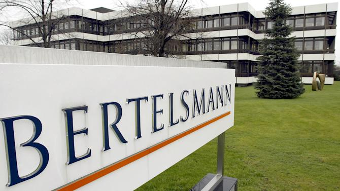 FILE - This March 13, 2003 file photo shows an outside view of the German media giant Bertelsmann in Guetersloh, Germany. British publishing and education company Pearson PLC and German media group Bertelsmann SE say they're merging their trade-book publishing companies, Random House and Penguin Group. In the deal announced by both companies Monday, Oct. 29, 2012, Bertelsmann will own 53 percent of the new company called Penguin Random House, and Pearson 47 percent. (AP Photo/Michael Sohn, File)