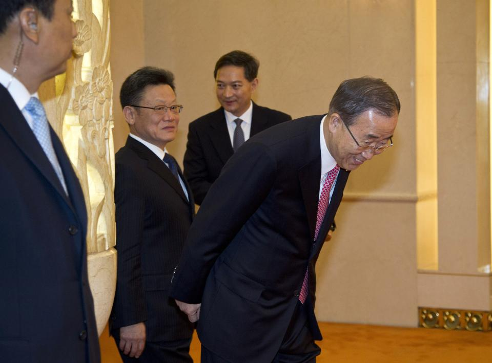 United Nations Secretary General Ban Ki-moon, right, bows as he arrives to meet with Chinese President Hu Jintao, not in picture, at the Great Hall of the People in Beijing, China Wednesday, July 18, 2012. (AP Photo/Andy Wong, Pool)