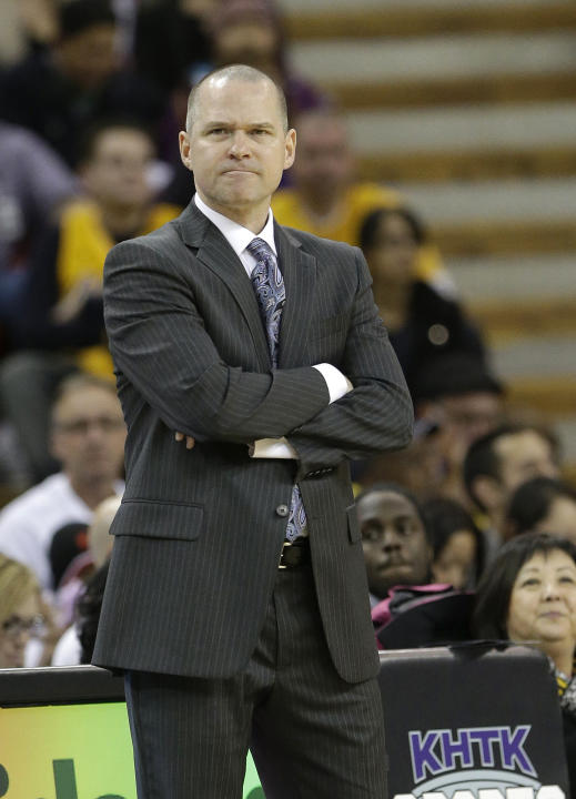 Sacramento Kings head coach Michael Malone grimaces as he watches the action during the fourth quarter of the Kings 106-100 loss to the Los Angeles Lakers in a NBA basketball game in Sacramento, Calif