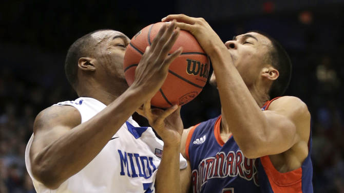 Middle Tennessee forward Neiko Hunter fouls St. Mary's guard Stephen Holt (14) during the first half of a first-round game of the NCAA men's college basketball tournament, Tuesday, March 19, 2013, in Dayton, Ohio. (AP Photo/Al Behrman)
