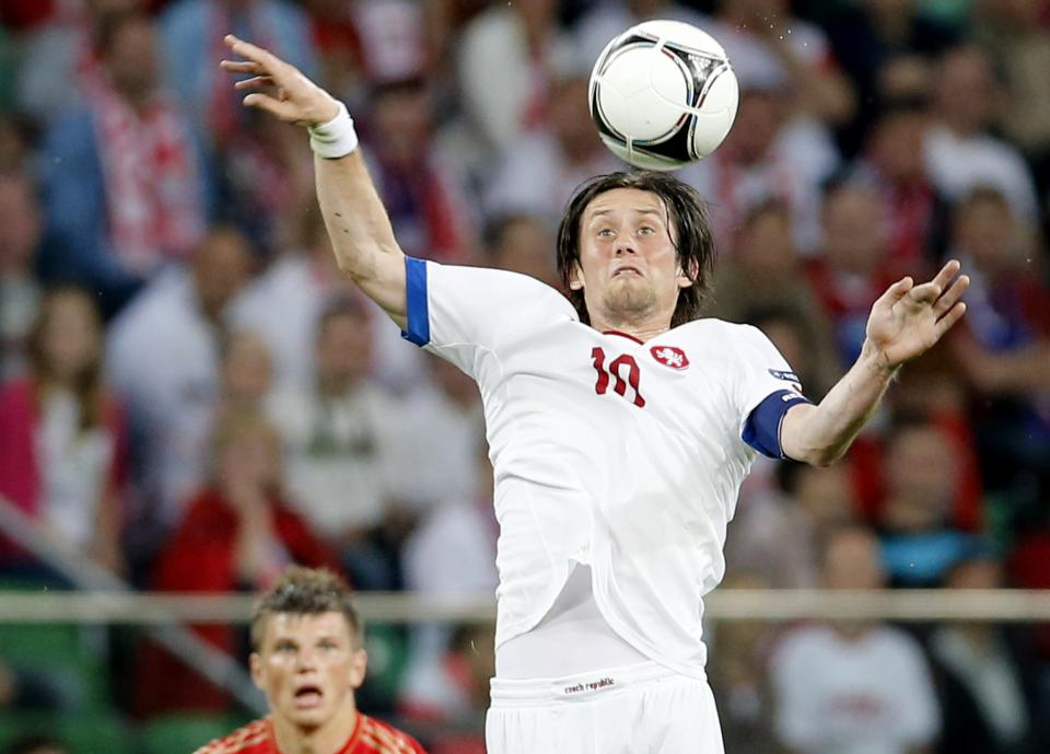 Czech Republic's Tomas Rosicky controls the ball as Russia's Andrei Arshavin looks on during the Euro 2012 soccer championship Group A match between Russia and Czech Republic in Wroclaw, Poland, Friday, June 8, 2012. (AP Photo/Antonio Calanni)