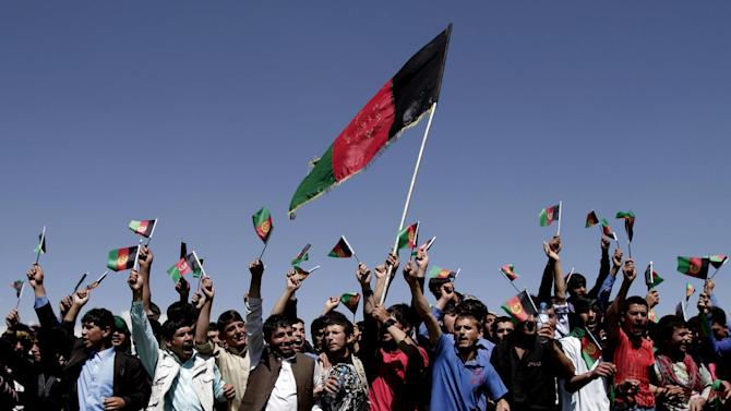 Protesters chant slogans against Pakistan as they wave Afghanistan flags during a demonstration in Kochkin area on the outskirts of Kabul, Afghanistan, Monday, May 6, 2013. Afghanistan says it has lodged an official protest with Pakistan after its forces allegedly came under fire along a contested stretch of their border. The Foreign Ministry says the incident along the eastern frontier took place early Monday at the same location where a firefight between Afghan and Pakistani forces killed an Afghan border policeman and wounded two Pakistani soldiers last week. (AP Photo/Rahmat Gul)