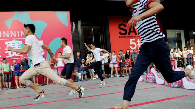 Men ran as they take part in a high-heels race in Taiyuan