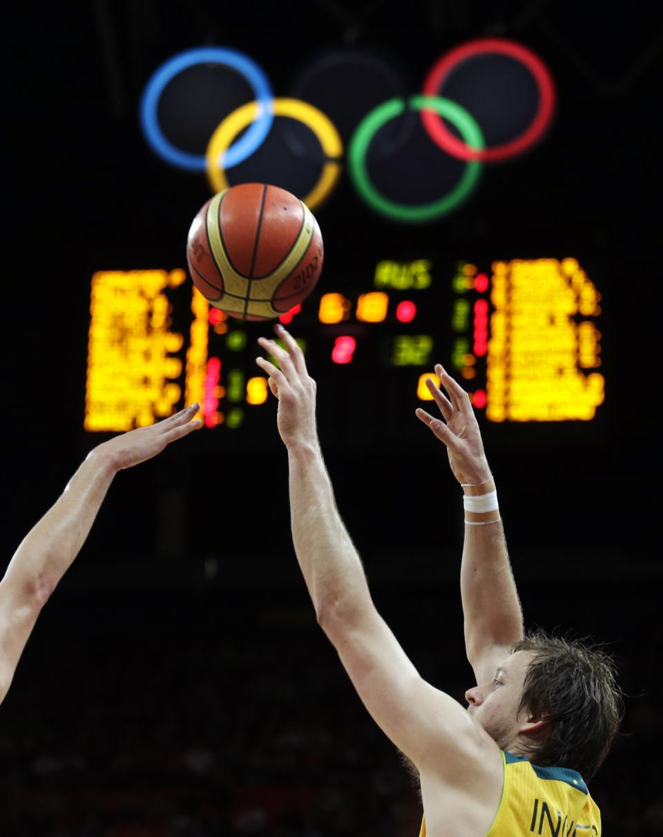 Australia's Joe Ingles shoots over Russia's Semen Antonov during a men's basketball game at the 2012 Summer Olympics, Monday, Aug. 6, 2012, in London. (AP Photo/Charles Krupa)