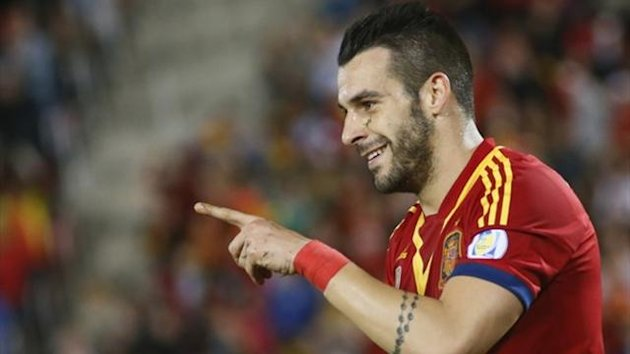 Spain's Alvaro Negredo celebrates after scoring a goal against Belarus (Reuters)