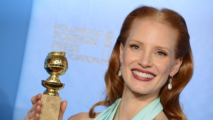 "Actress Jessica Chastain poses with the award for best performance by an actress in a motion picture - drama for ""Zero Dark Thirty"" backstage at the 70th Annual Golden Globe Awards at the Beverly Hilton Hotel on Sunday Jan. 13, 2013, in Beverly Hills, Calif. (Photo by Jordan Strauss/Invision/AP)"