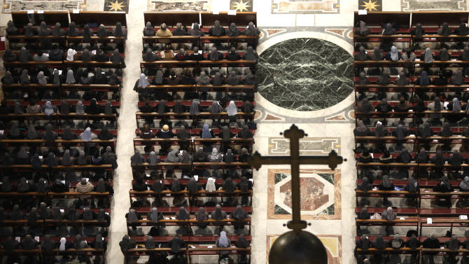 Nuns pray inside St. Peter's Basilica at the Vatican, Tuesday, Feb. 12, 2013. With a few words in Latin, Pope Benedict XVI did what no pope has done in more than half a millennium, stunning the world by announcing his resignation Monday and leaving the already troubled Catholic Church to replace the leader of its 1 billion followers by Easter.  (AP Photo/Alessandra Tarantino)