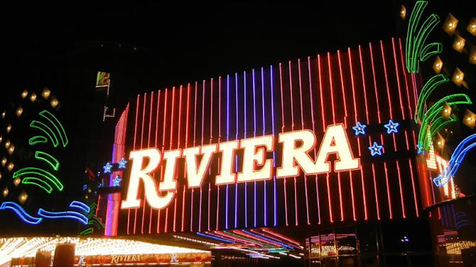 FILE - This Feb. 16, 2015 file photo shows the Riviera Hotel and Casino on the Las Vegas Strip. The aging Riviera Hotel and Casino on the Las Vegas Strip will age no more as of noon. The 60-year-old casino-hotel is expected to close its doors at that hour Monday, May 4, 2015.  (AP Photo/Kimberly Pierceall, File)